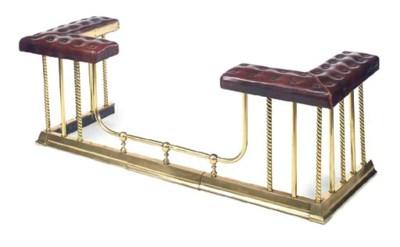 An upholstered brass club fend