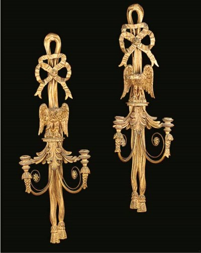 A pair of carved gilt wood twi