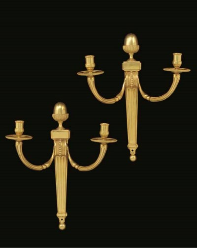 A pair of gilt bronze twin-lig