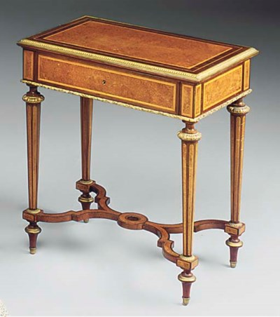 A FRENCH MAHOGANY BURR-VENEERE