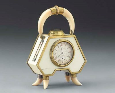 An ivory and tusk mounted time