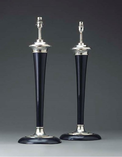 A pair of ebonised wood and si