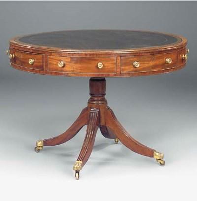 A MAHOGANY DRUM TABLE