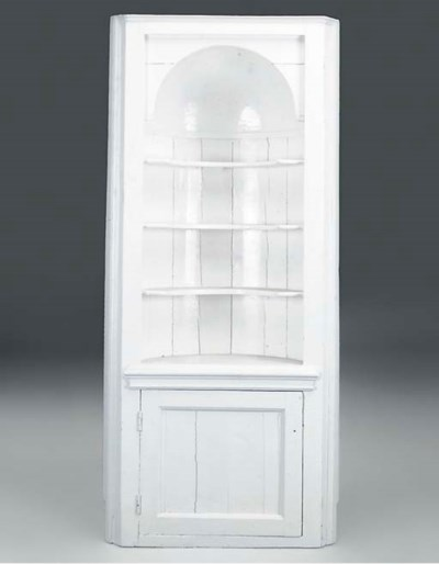 A white painted corner cabinet
