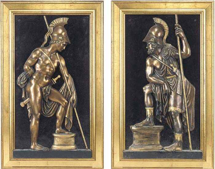 A pair of relief cast painted