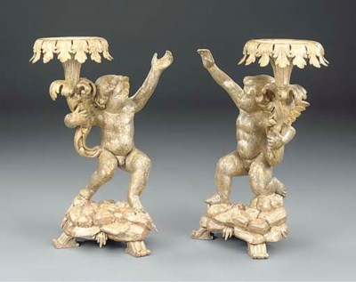 A PAIR OF CARVED AND SILVERED