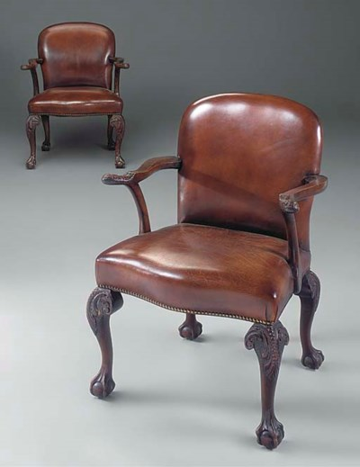 A PAIR OF CARVED WALNUT ARMCHA