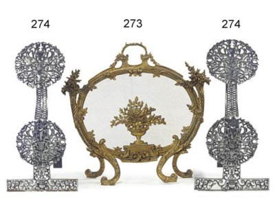 A gilt brass fire screen