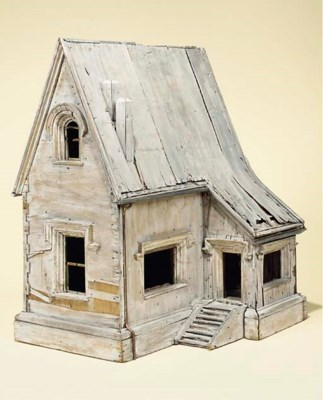 A PAINTED WOOD BIRD HOUSE