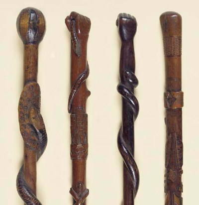 FOUR CARVED WOOD WALKING STICK