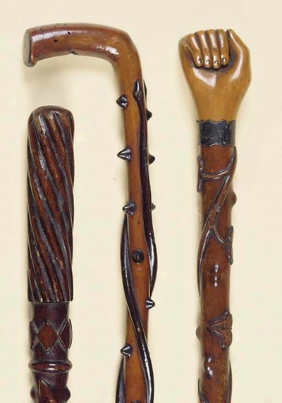 THREE CARVED WOOD WALKING STIC