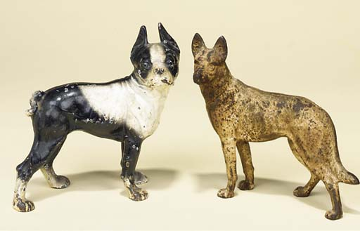 TWO CAST-IRON MODELS OF DOGS