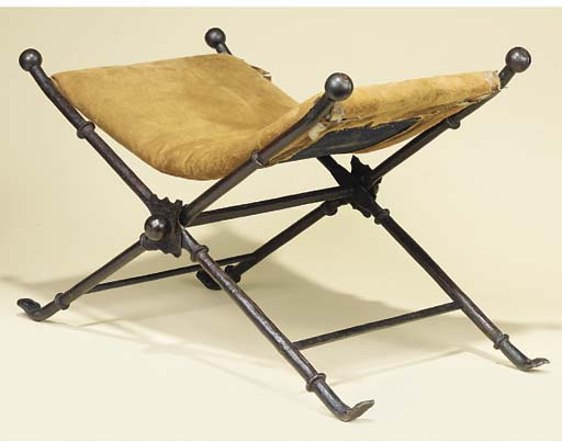 AN ITALIAN FOLDING IRON STOOL