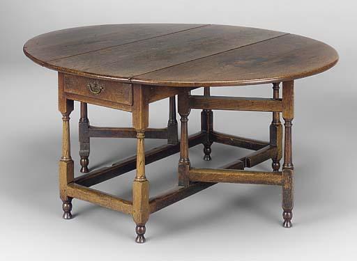AN ENGLISH OAK GATELEG TABLE