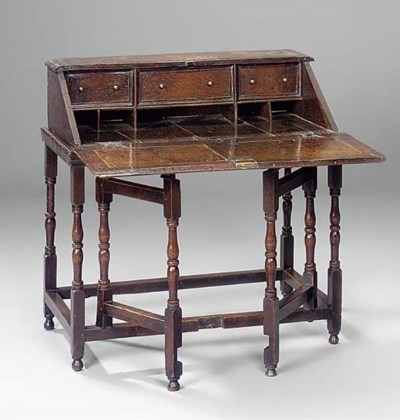 AN ENGLISH OAK DESK ON STAND