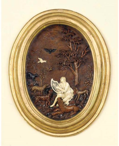 A GERMAN IVORY AND WOOD RELIEF