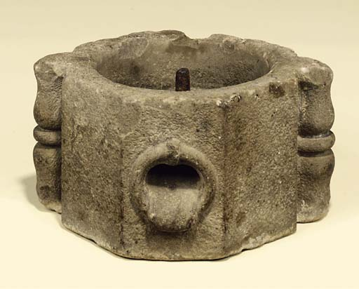 AN ENGLISH CARVED QUERN STONE
