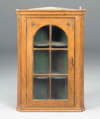 A pine corner cupboard
