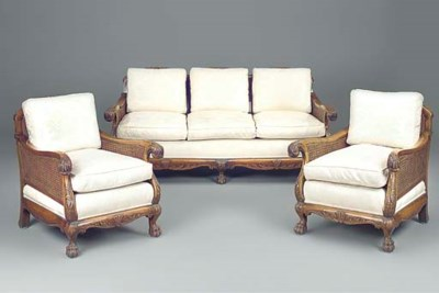 A walnut and caned sofa and ac