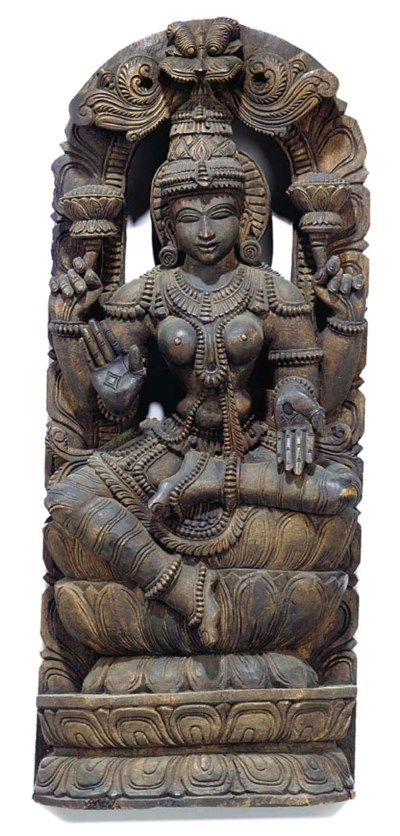 AN INDIAN CARVED WOOD SCULPTUR