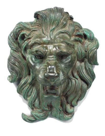 A BRONZE LION'S HEAD WALL MASK