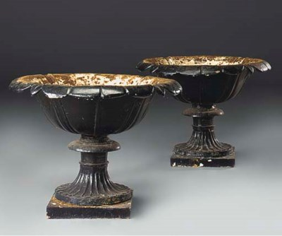 A pair of cast iron urns