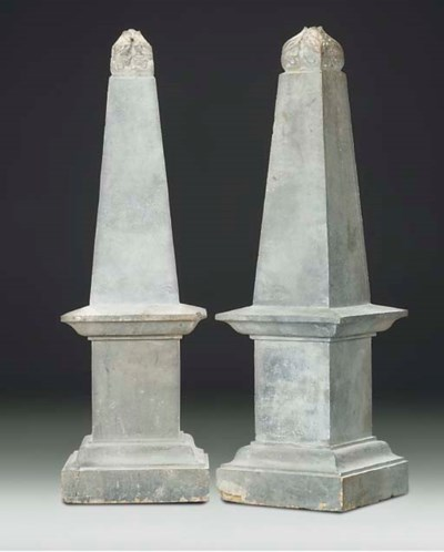 A PAIR OF COMPOSITE STONE OBEL