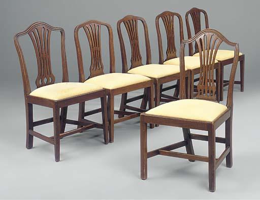 A set of four mahogany dining