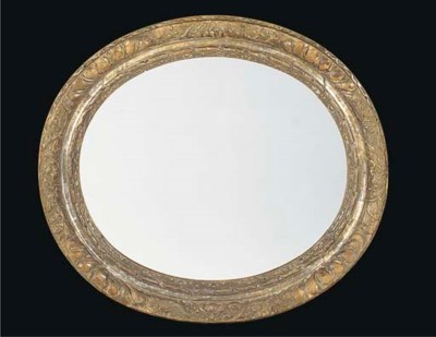 AN OVAL CARVED AND SILVERED PI