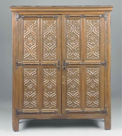 AN ENGLISH CARVED OAK PANELLED