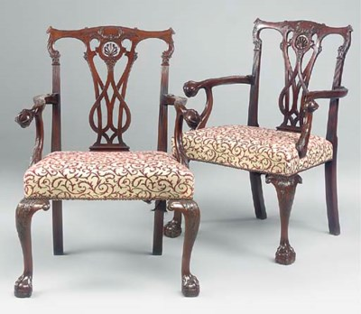 A pair of carved mahogany open