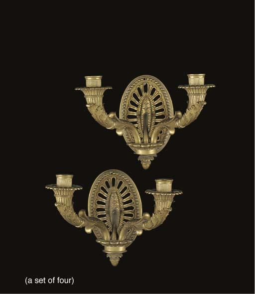 A set of four gilt-bronze twin