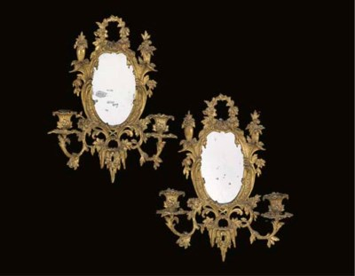 A pair of gilt-brass twin-ligh