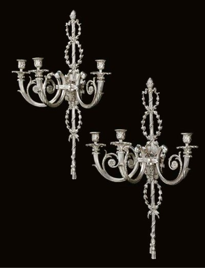 A pair of silvered bronze thre
