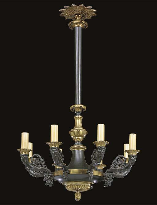 A gilt and patinated metal eig