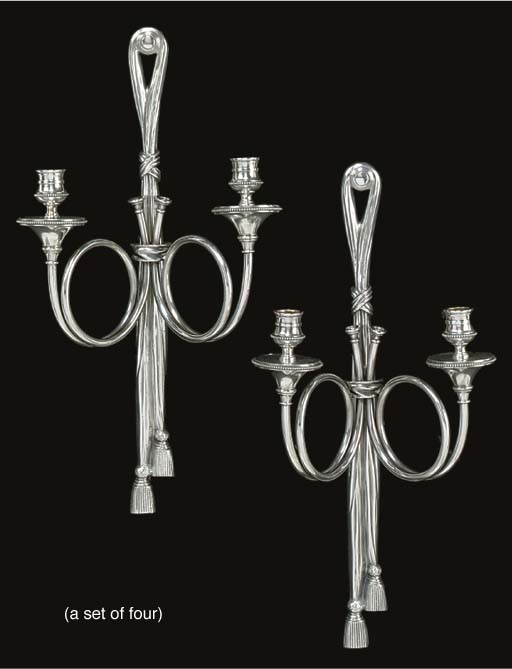 A set of four silvered metal t