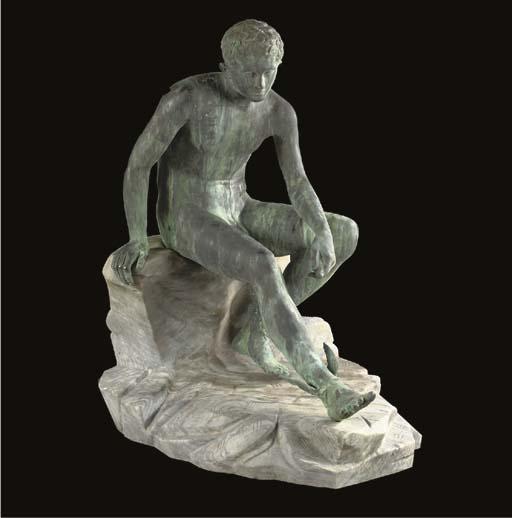 A bronze figure of seated Merc