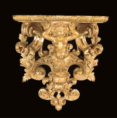 A CARVED GILTWOOD WALL BRACKET