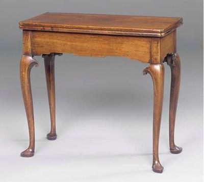 A GEORGE II WALNUT TEA TABLE