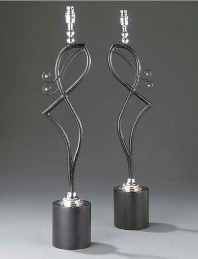 A pair of black painted iron a