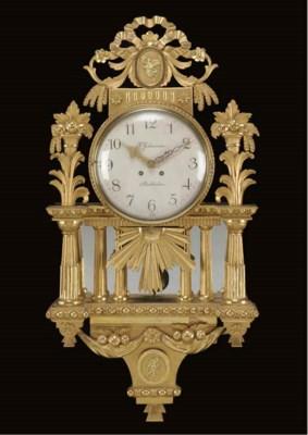 A Swedish giltwood wall clock