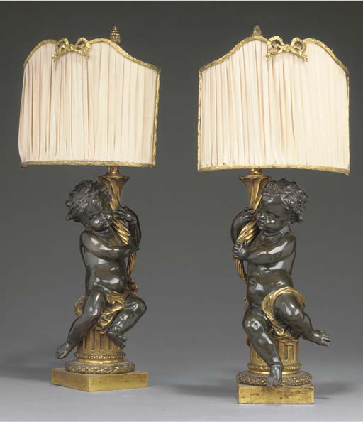 A pair of French gilt and bron