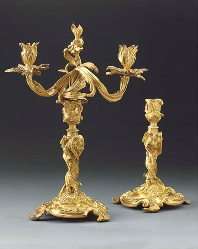 A pair of gilt bronze twin lig