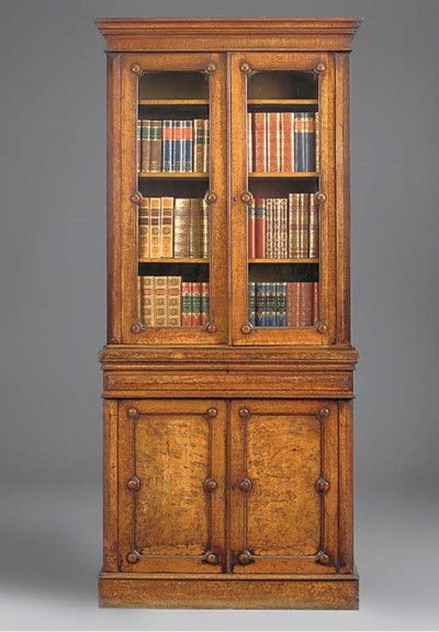 AN EARLY VICTORIAN OAK AND POL
