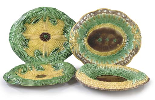 FOUR VARIOUS MAJOLICA BREAD PL
