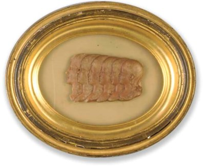 A pink wax RELIEF of THE CHILD