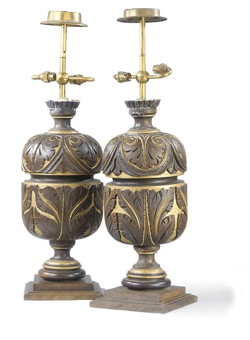 A PAIR OF GILT AND CARVED WOOD