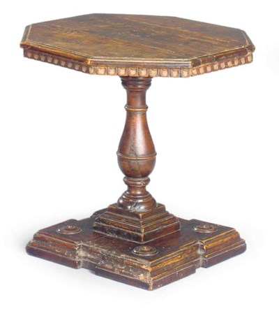 A TUSCAN WANLUT TRIPOD TABLE
