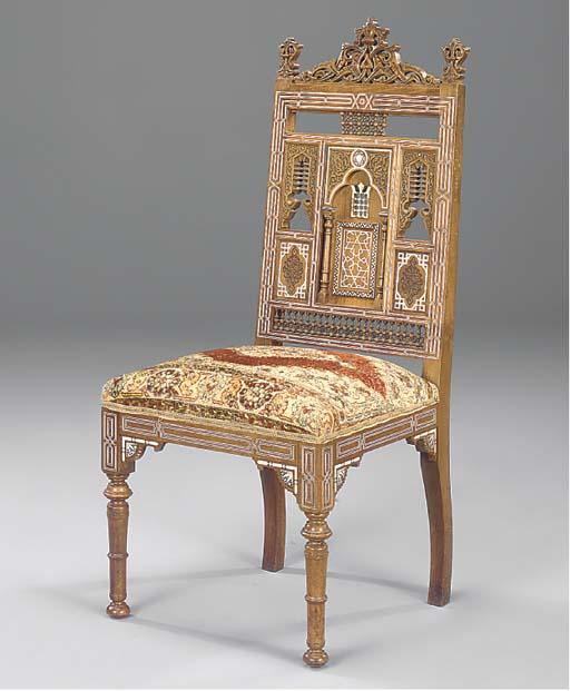 A WALNUT AND INLAID CHAIR