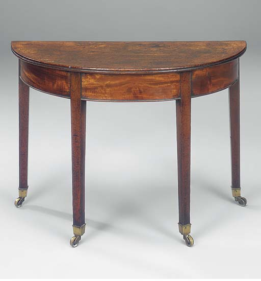 A mahogany demi-lune table